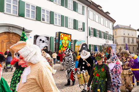 Muensterberg, Basel, Switzerland - March 12th, 2019. Carnival marching group with colorful costumes Redakční