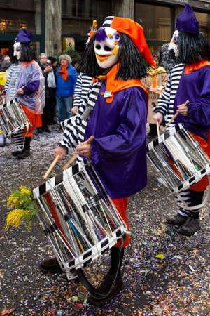 Staenzlergasse, Basel, Switzerland - March 11th, 2019. Close-up of a snare drummer in purple orange carnival costume Redakční