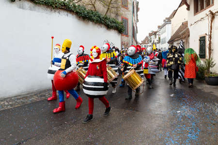 Heuberg, Basel, Switzerland - March 11th, 2019. Close-up of a carnival marching group in colorful costumes Reklamní fotografie - 124413307
