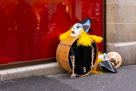 Steinenbachgaesslein, Basel, Switzerland - March 11th, 2019. Close-up of a drum and carnival masks Redakční
