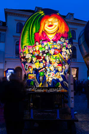 Muensterplatz, Basel, Switzerland - March 12th, 2019. A hand painted colorful illuminated carnival lantern displayed on the cathedral square Redakční
