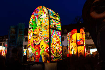 Muensterplatz, Basel, Switzerland - March 12th, 2019. Several hand painted colorful illuminated carnival lanterns displayed on the cathedral square Reklamní fotografie - 124413312