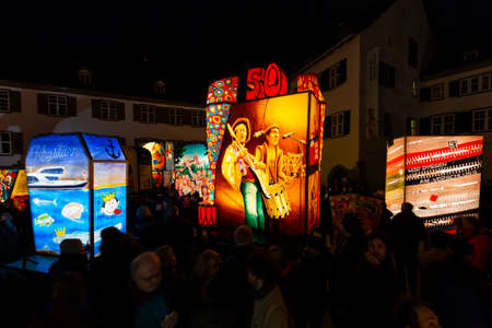 Muensterplatz, Basel, Switzerland - March 12th, 2019. Several hand painted colorful illuminated carnival lanterns displayed on the cathedral square