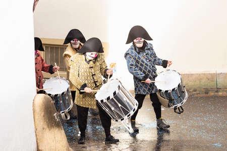 Rheinsprung, Basel, Switzerland - March 13th, 2019. Group of snare drummers walking around the corner