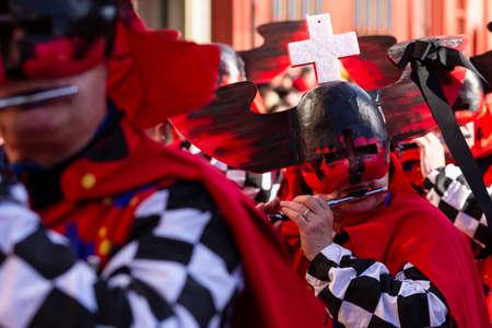 Marktplatz, Basel, Switzerland - March 13th, 2019. Portrait of a carnival piccolo player in red costume