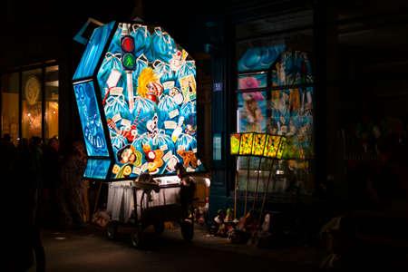 Spalenberg, Basel, Switzerland - March 11th, 2019. A single blue illuminated main lantern parked besides a restaurant. Reklamní fotografie - 124413334