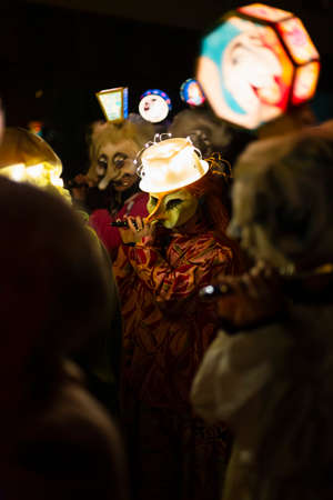Marktgasse, Basel, Switzerland - March 11th, 2019. Close-up of piccolo players in their individual carnival costumes with illuminated head lanterns. Reklamní fotografie - 124413337