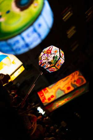Schneidergasse, Basel, Switzerland - March 11th, 2019. Close-up of several colorful illuminated carnival pole lanterns. Redakční