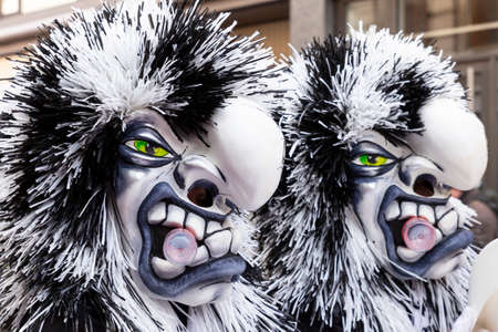 Freie Strasse, Basel, Switzerland - March 12th, 2019. Close-up of two beautiful black and white carnival masks