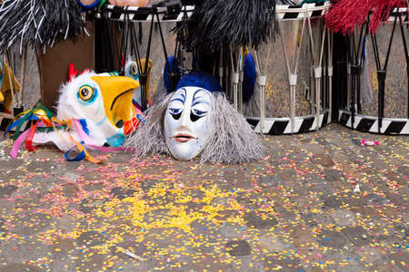 Augustinergasse, Basel, Switzerland - March 12th, 2019. Carnival masks and snare drums piled up in a street corner
