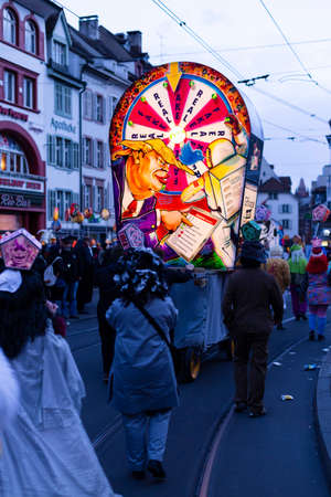 Barfuesserplatz, Basel, Switzerland - March 11th, 2019. One main illuminated carnival lantern sticking out from the crowd in the old town.