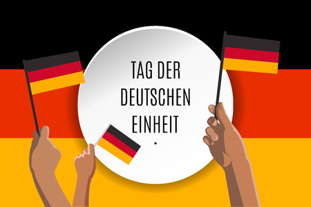 Happy Unity Day placard, poster or greeting card translated in German. Text in circle banner and hands with german flags on Deutschland flag background. Vector illustration of Germany Independence Day