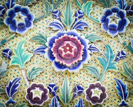 Ceramic carving multi color flower on wall in temple thailand  photo