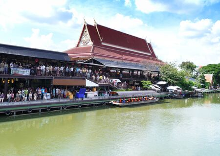 Many people in temple side river thailand