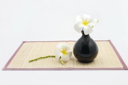 Hanging bamboo basket of flowers bamboo sheets vase isolated