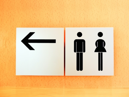 Black man and woman sign restroom Stock Photo