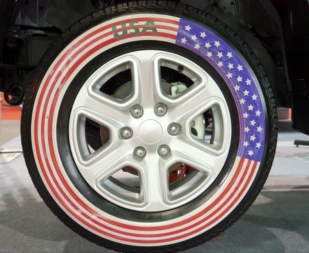 Wheel car USA flag in motor show . photo
