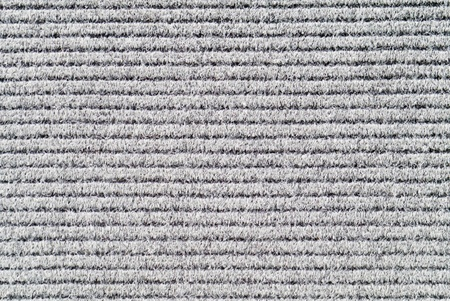 Grey textured background of carpet.