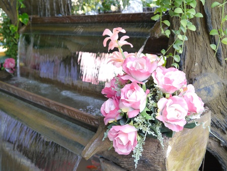 waterfall model: Colorful pink and white roses on the waterfall model.