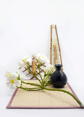 Hanging bamboo basket of flowers bamboo sheets vase isolated  photo