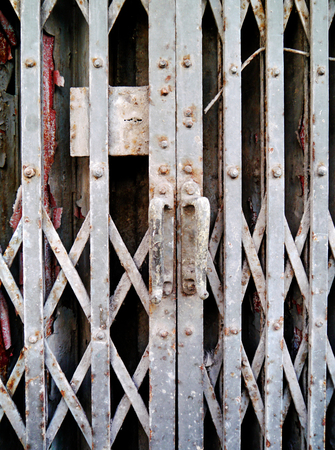 reachability: Old grating door art background. Stock Photo