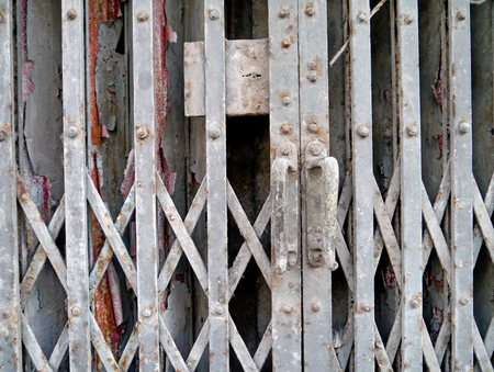 reachability: Old grating door art background. Stock Photo