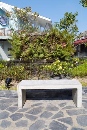 furniture part: Stone seat in garden.