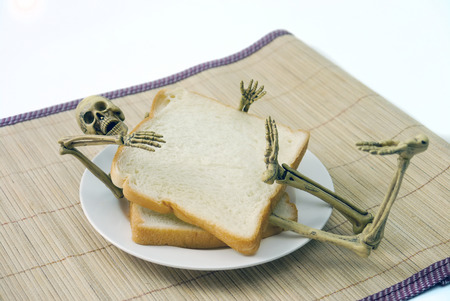 Human skeleton sanwich breakfast  halloween on white background.