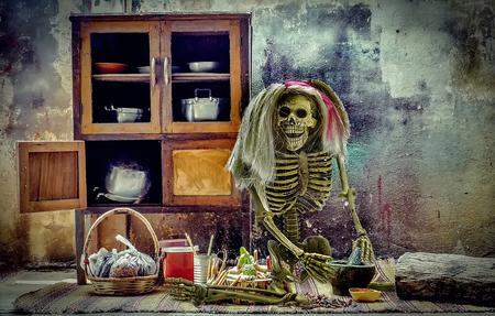 Ghost skeleton cooking thai food on halloween night add grain vignett still life style. Stock Photo