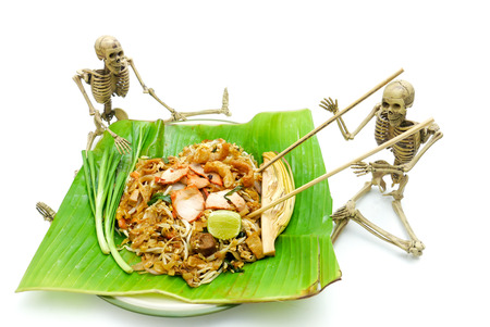 Ghost skeleton eating pad thai noddle on halloween night white background.