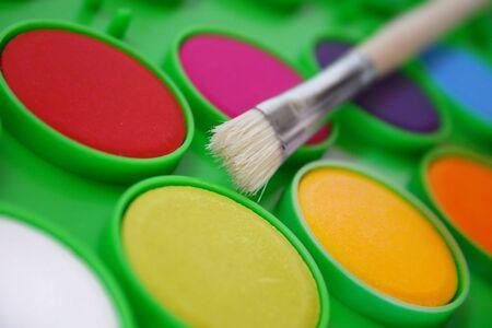 emulsion: Colourful paing and paintbrush Stock Photo