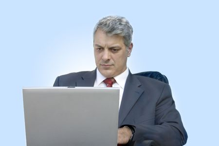 Businessman working at his laptop photo