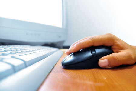 Hand on the mouse photo