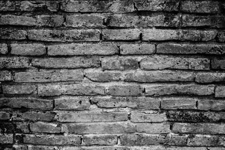The brick wall of the black and white color, wide panorama of masonry.Old brick wall. Horizontal wide brick wall background. Vintage house facade.Exterior brick wall texture background. Zdjęcie Seryjne
