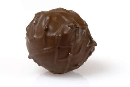 Dark truffle chocolate isolated over a white background Stock Photo