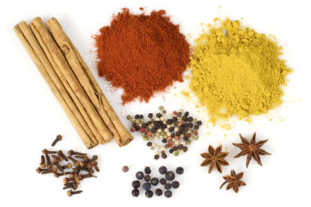 Various colorful spices from above isolated over a white background