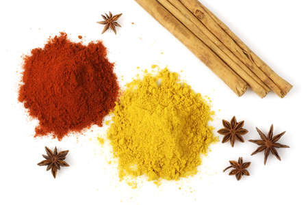 Various colorful spices from above isolated over a white background photo