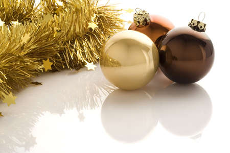 Three christmas balls isolated over a white background