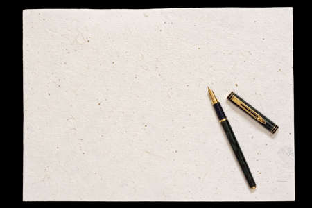 Pen and old paper isolated on black background photo