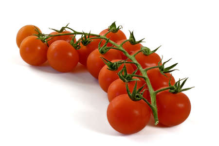 Bunch of tomatoes isolated over a white background photo