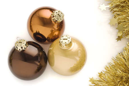 Three christmas balls isolated over a white background photo