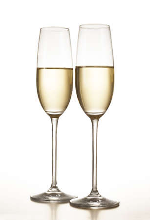 Two champagne flutes isolated over a white background