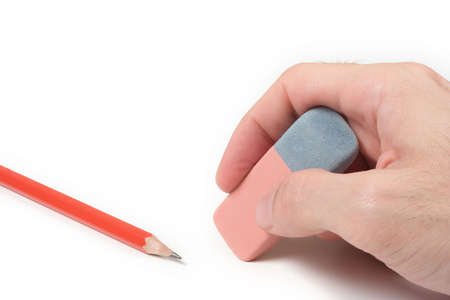 rectify: Hand with eraser and pencil over a white background Stock Photo