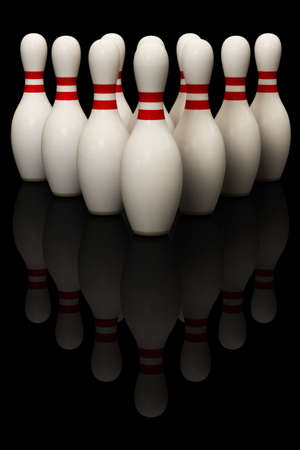Bowling pins isolated over a black background. This is a 3D rendered picture.