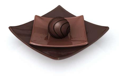 plato del buen comer: Trufas de chocolate en un plato aislados en un fondo blanco.