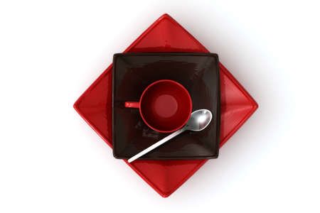 expresso: Red and dark brown empty expresso cup and saucers isolated over a white background. View from above.