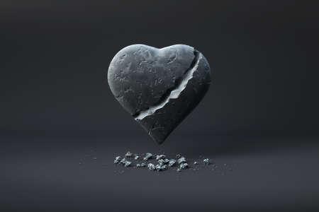 Broken heart of stone over a dark background.