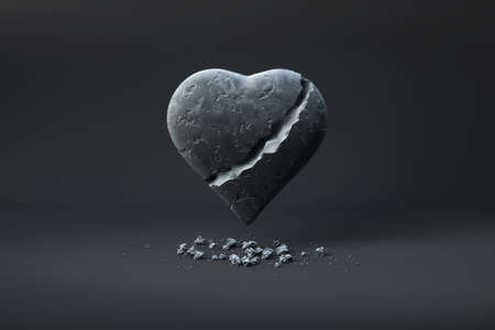 heart of stone: Broken heart of stone over a dark background.