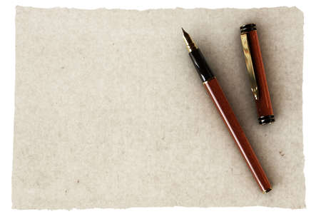 antic: Elegant fountain pen over an old empty piece of parchment.
