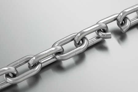 broken link: Chain with broken link over a metallic gray background